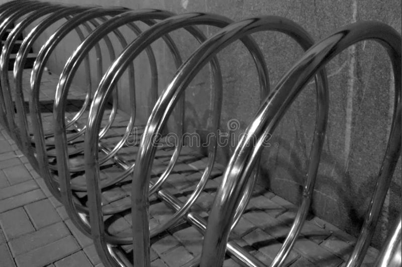 Empty parking space for bicycles in front of the store. Bicycle parking in a public area. Empty bicycle parking lot on the street royalty free stock photos