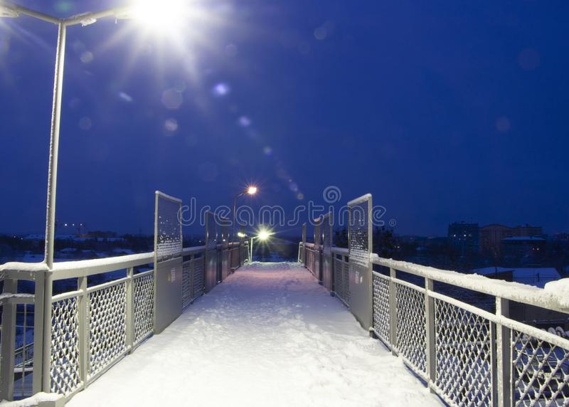 Empty pathway on the overpass bridge under the sky train railway track at winter morning. Empty pathway on the overpass bridge under the sky train railway track royalty free stock image