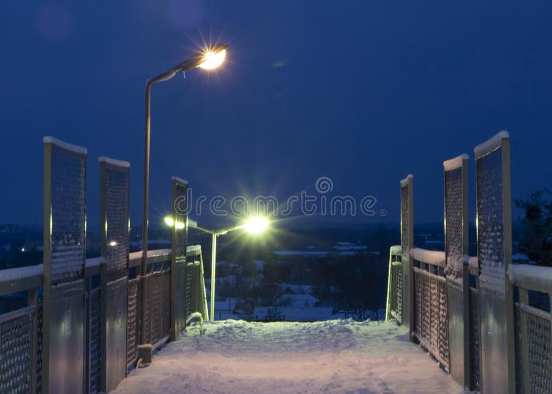 Empty pathway on the overpass bridge under the sky train railway track at winter morning. Empty pathway on the overpass bridge under the sky train railway track royalty free stock images