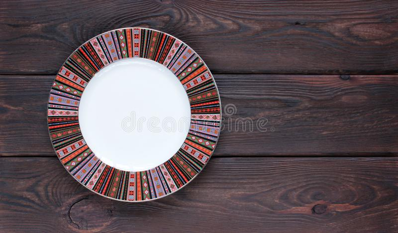 Empty plate on wooden table Top View with Text Space good stock photography