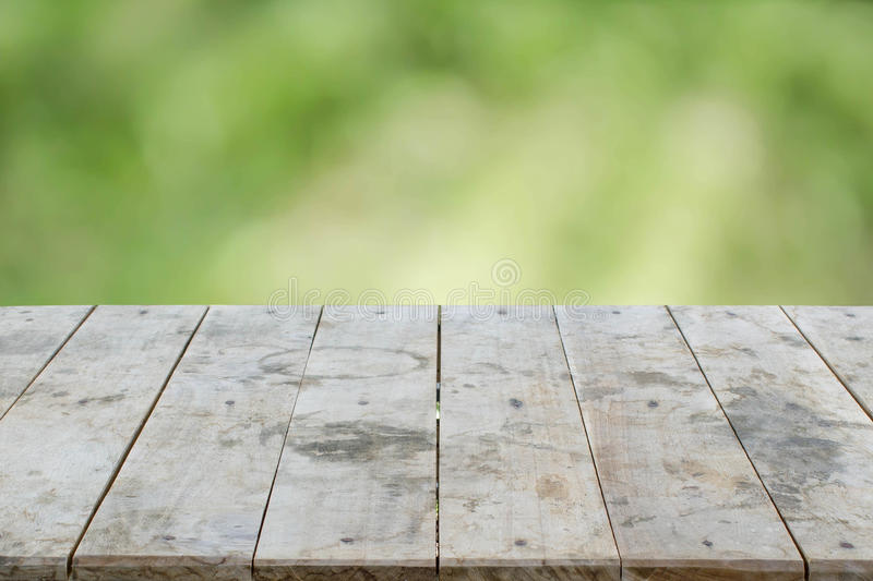 empty perspective grungy wood table top texture on blurred nature background royalty free stock photos