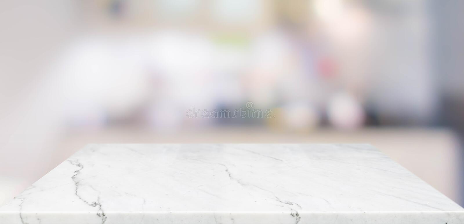 Empty perspective marble table top with blurred home kitchen background.Mock up template for display or montage of your design,. Banner for advertise of product royalty free stock images