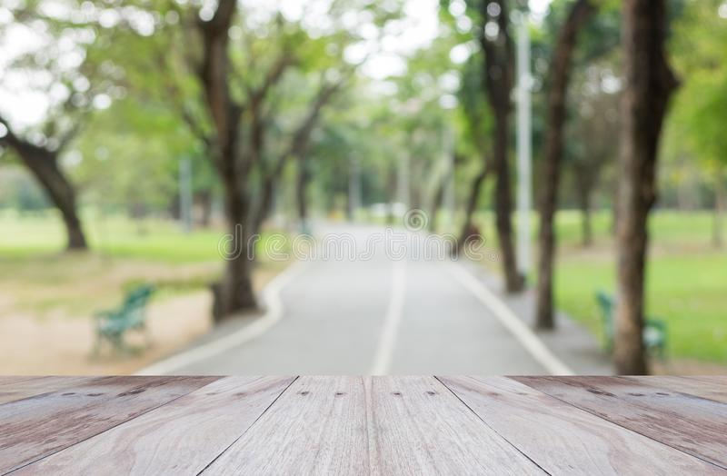 Empty perspective white wood over blurred trees stock image