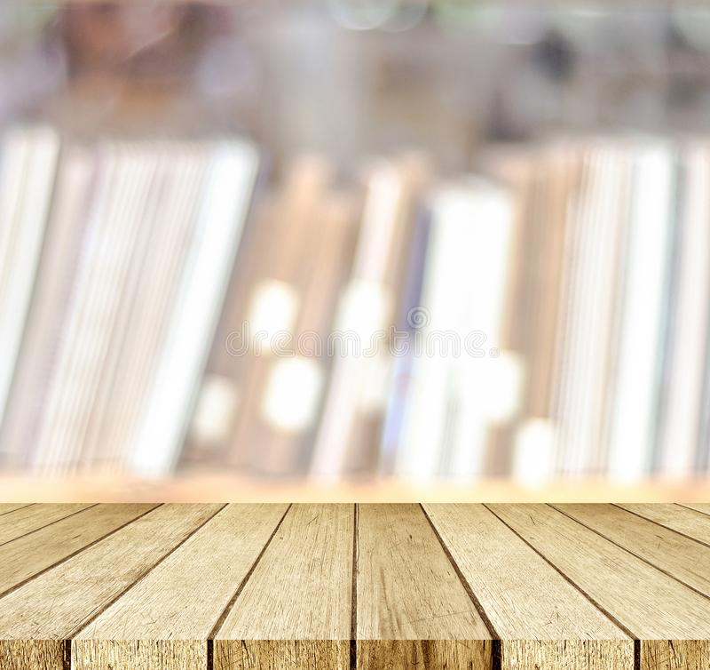Empty perspective wood, table, shelf, over blur bookshelves at b. Ook store background, for product display montage, education concept stock photos