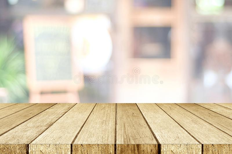 Empty perspective wood, tabletop, over blur restaurant with bokeh light background, food and product display montage background royalty free stock photography