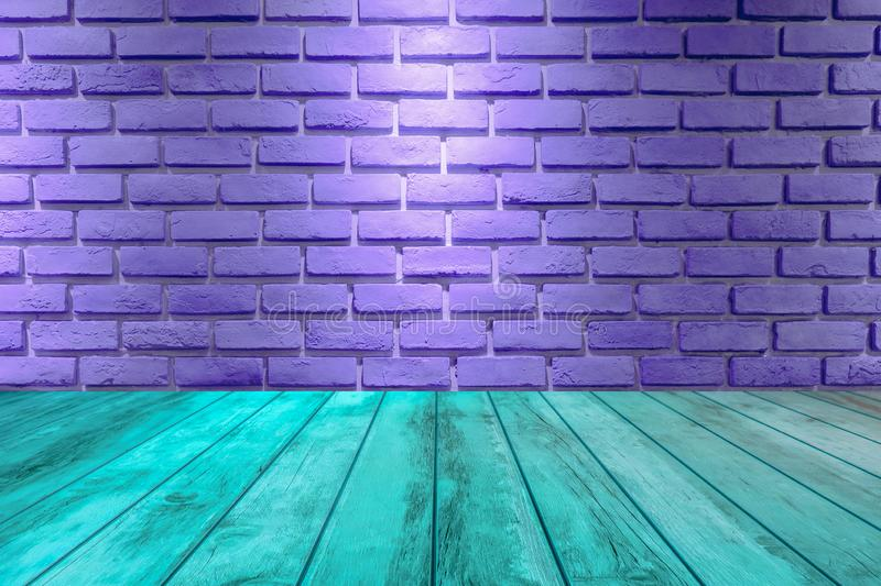 empty perspective wooden floor and  purple brick wall texture royalty free stock image