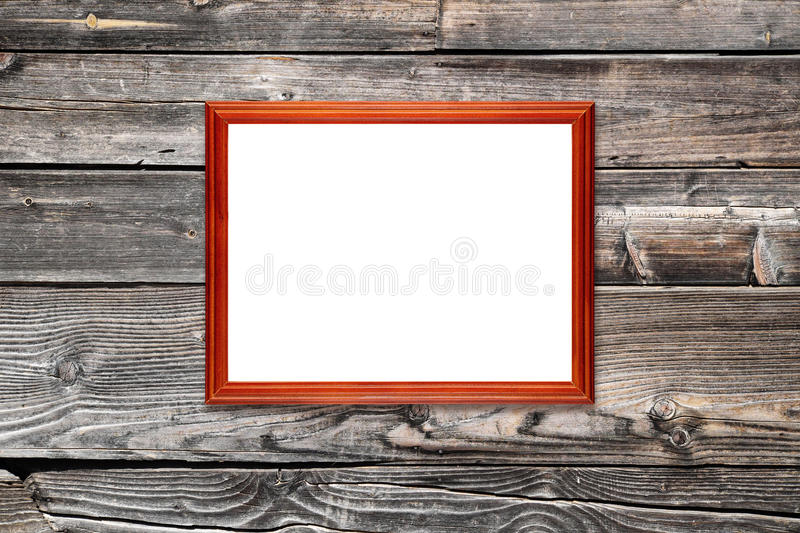 Empty photo frame on wooden wall royalty free stock image