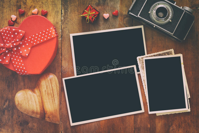 Download Empty Photo Frames Next To Old Camera And Hearts Stock Photo - Image: 83708078
