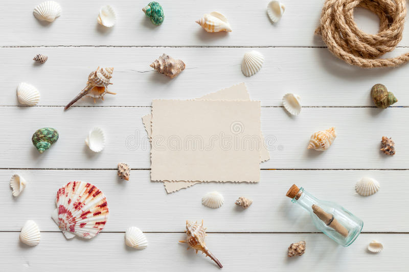 Empty photo for inside and nautical life style items. Retro bottle with message, sea shells, chest, rope. Marine concept stock images