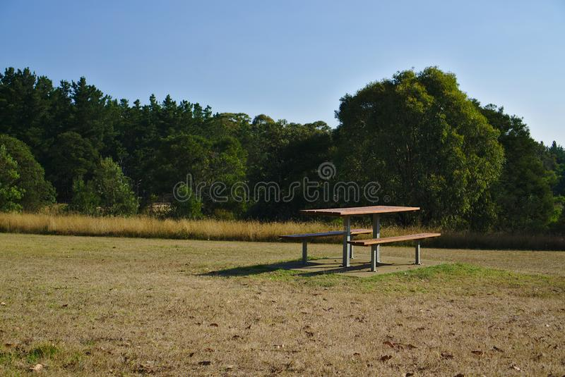 Empty picnic table in park royalty free stock photo