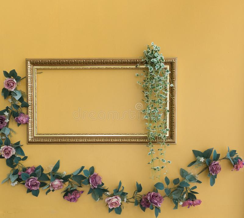 Empty picture frame with artificial flowers royalty free stock photography