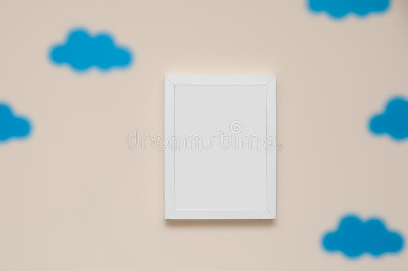 Empty picture frame on a bedroom wall to add your own photograph stock photography