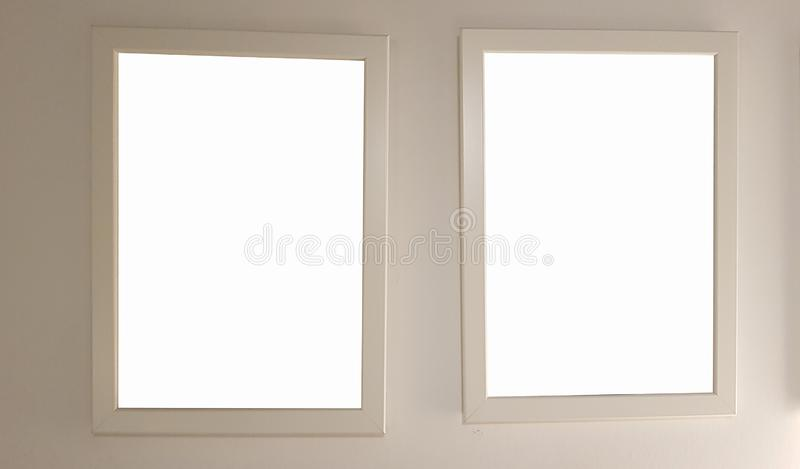 Two Empty Frame On The Shelf With Books.Blank Advertisement Banner Poster Mock Up Isolated Template Clipping Path. Empty Picture Frame Blank Advertisement Banner stock photos