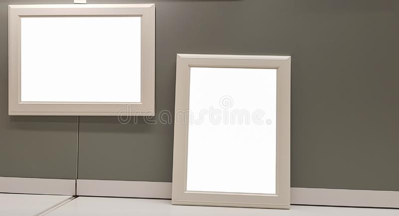 Two Empty Frame On The Shelf With Books.Blank Advertisement Banner Poster Mock Up Isolated Template Clipping Path. Empty Picture Frame Blank Advertisement Banner royalty free stock image