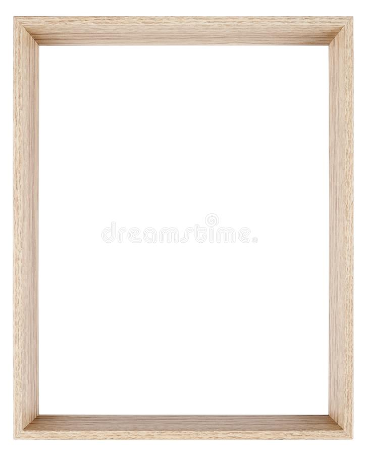 Empty picture frame in a wood grain moulding. Empty picture frame isolated on white in a deeply recessed wood grain moulding royalty free stock photo