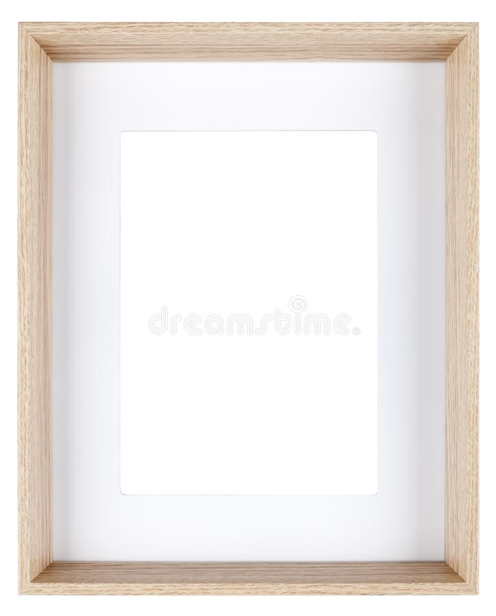 Empty picture frame in a wood grain moulding. Empty picture frame isolated on white in a deeply recessed wood grain moulding with a mount stock photos