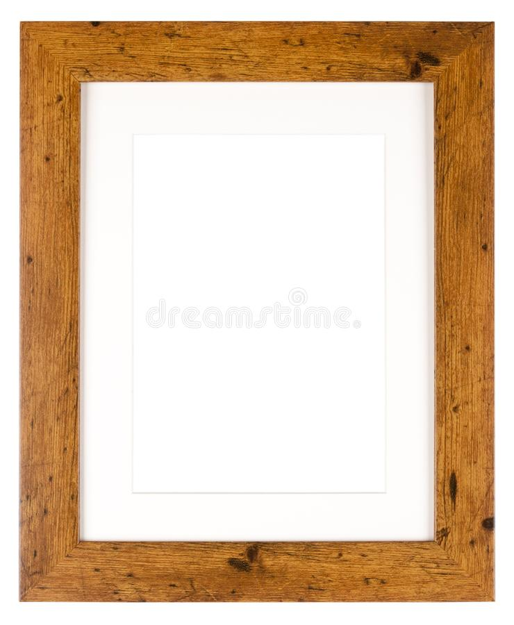 Empty picture frame in a wood grain moulding. Empty picture frame isolated on white in a simple wood grain moulding with a mount stock images
