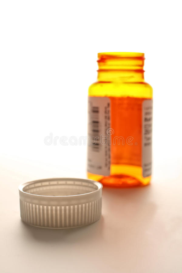 Empty Pill Bottle and Cap. On white background stock photos
