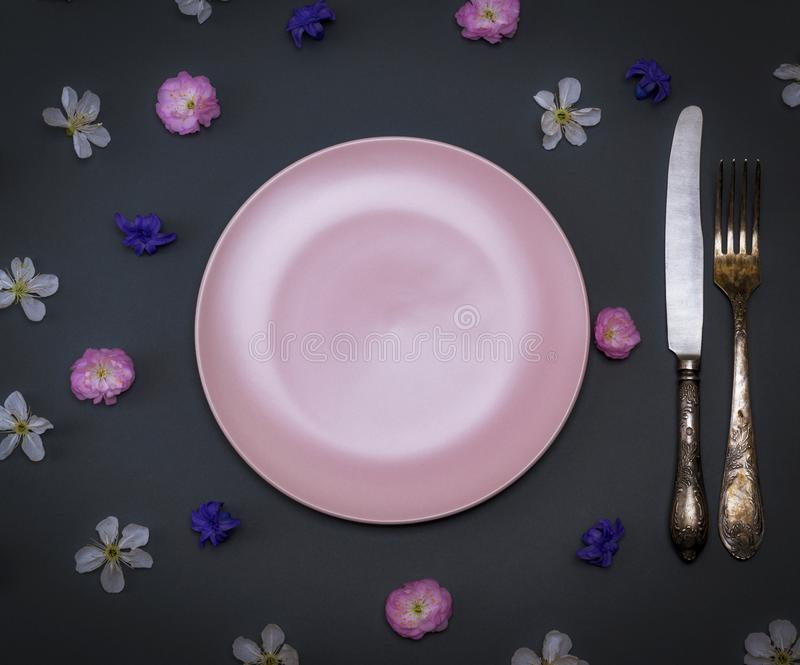 Download Empty Pink Ceramic Plate And Iron Vintage Knife With A Fork On A Stock Photo & Empty Pink Ceramic Plate And Iron Vintage Knife With A Fork On A ...