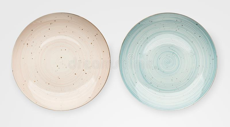 Empty pink ceramic plates isolated stock images