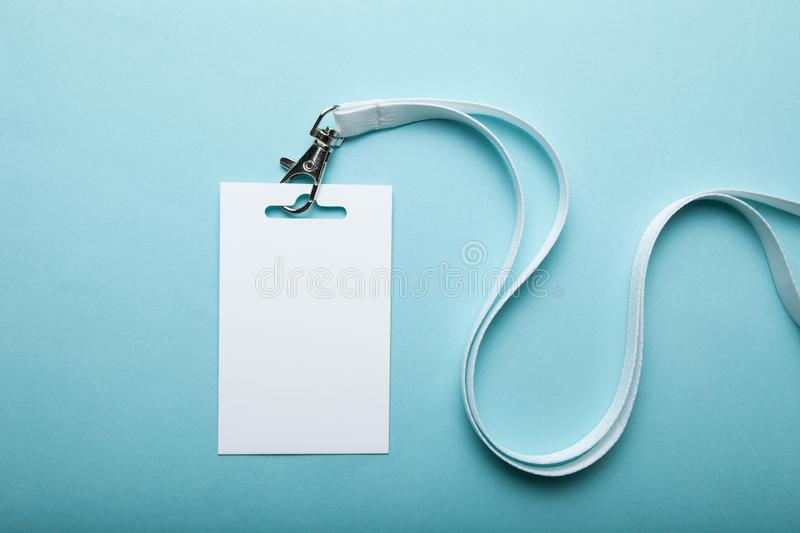 Empty plain name tag mock up, on blue background. Business blank badge.  royalty free stock photo