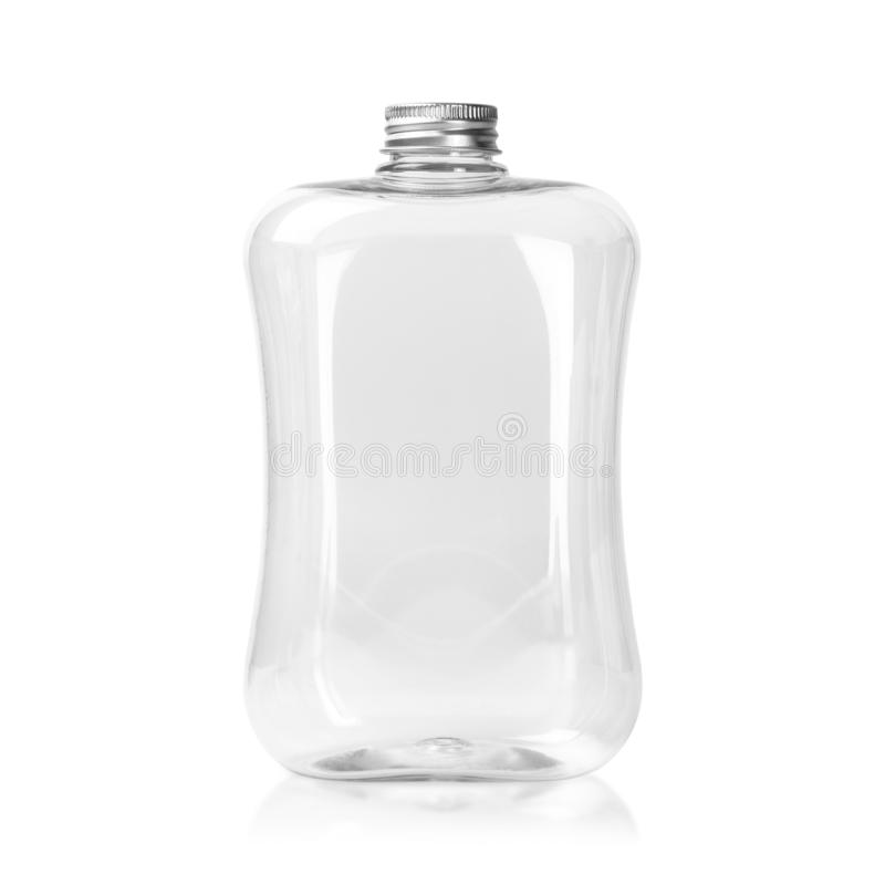 Empty plastic bottle with silver cap isolated on white background. Clear Jar or Mason package.  Clipping path. Empty plastic bottle with silver cap isolated on stock images