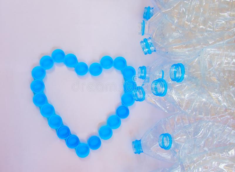 Empty plastic bottles of water for recycle with heart shape from bottle cap royalty free stock photos