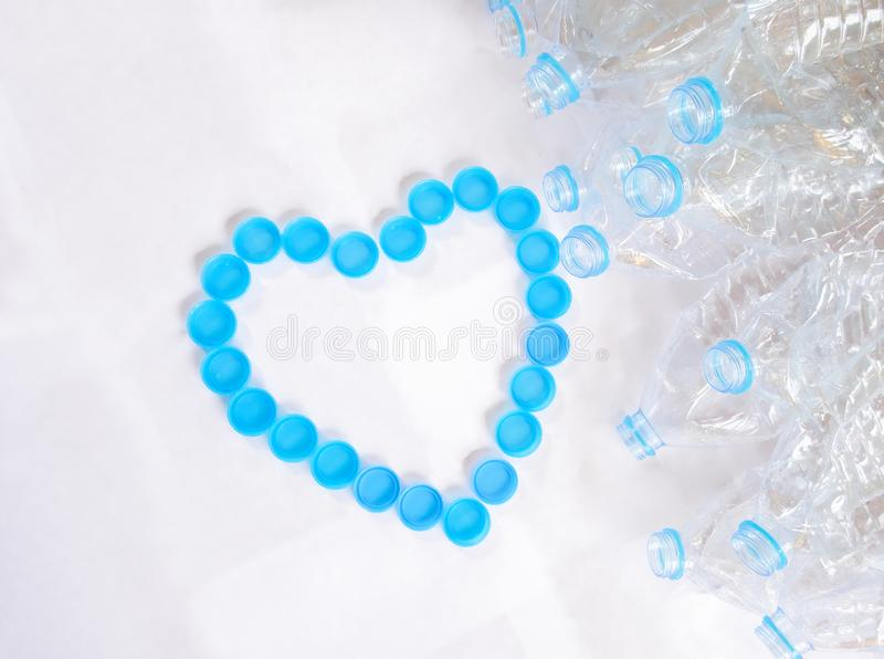 Empty plastic bottles of water for recycle with heart shape from bottle cap royalty free stock image