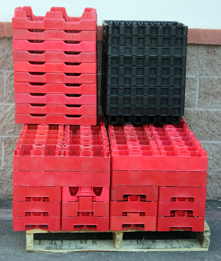 Empty Plastic Boxes. Empty red and black plastic boxes for cola bottles stock image