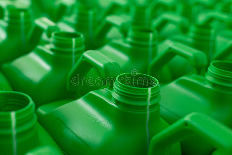 Empty plastic cans green color. royalty free stock photos