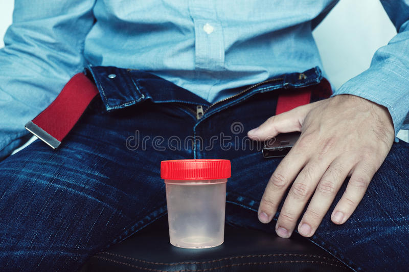 Empty plastic container for testing semen or urine royalty free stock photo