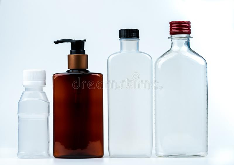 Empty plastic and glass bottle with cap and pump with black label isolated on white background. Pharmaceutical products bottle stock photos