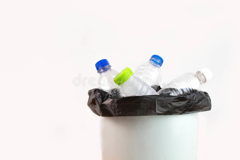 Empty plastic water bottle in recycling bin waiting to be taken to recycle. Concept save the earth royalty free stock photos