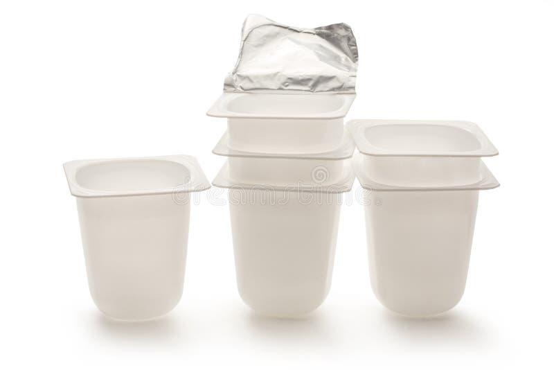Empty plastic yogurt pots stock image. Image of disposable ...
