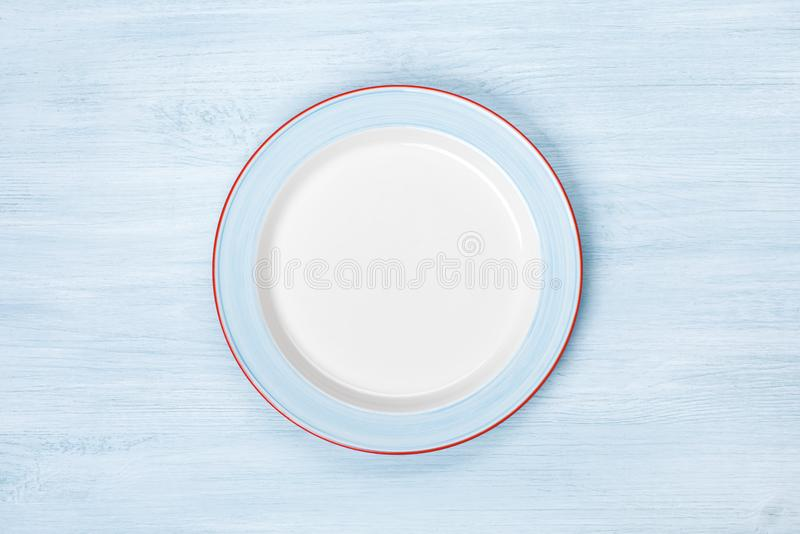 Empty plate on blue wooden table. Top view with copyspace royalty free stock images