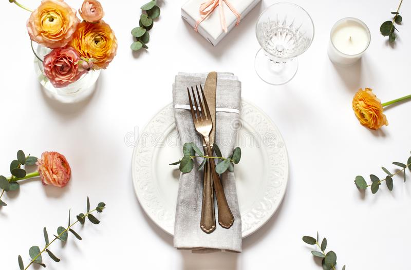 Empty plate concept flat lay with floral decorations on the white backdround. Top view Valentines day, Mothers day or Easter card stock photos