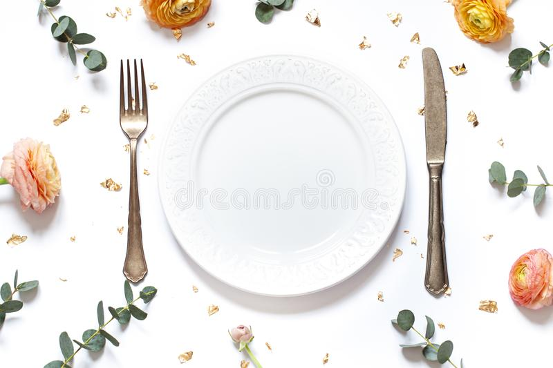 Empty plate concept flat lay with floral decorations on the white backdround. Top view Valentines day, Mothers day or Easter card. Copy space stock photography