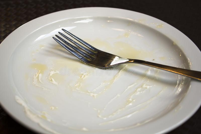 An empty plate, dirty after the meal is finished. Top view royalty free stock photography