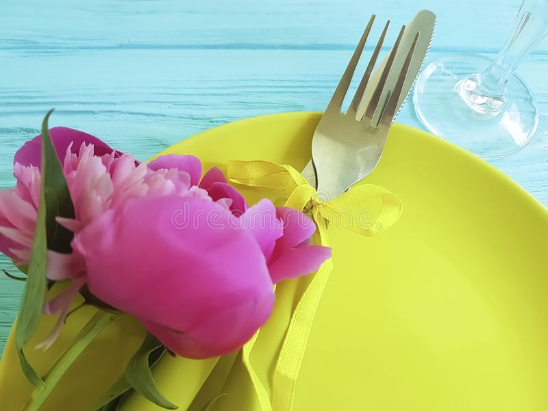 Empty plate flower peony holiday plank birthday romantic on blue wooden background. Empty plate flower peony romantic blue wooden background design birthday royalty free stock image