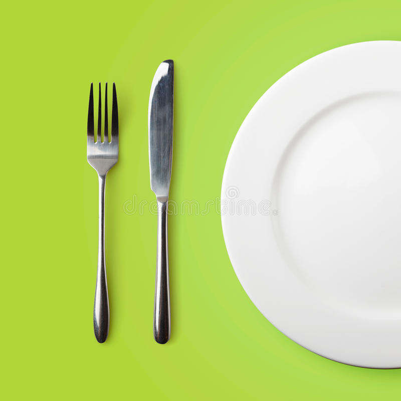 Empty plate, fork and knife royalty free stock photos