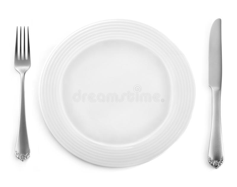 Empty plate with fork and knife royalty free stock photo