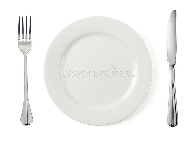 Empty plate with fork and knife stock image