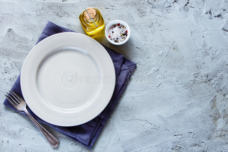 Empty plate and fork stock images