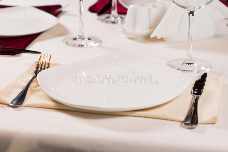 Empty plate on a formal dinner table stock images