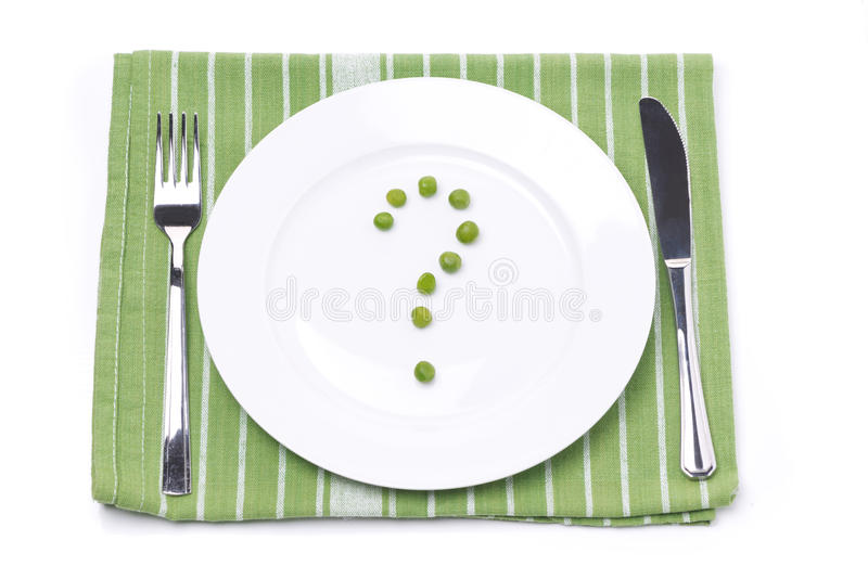 Download Empty Plate With Green Peas In The Shape Of A Question Mark Royalty Free Stock Photography - Image: 38054987