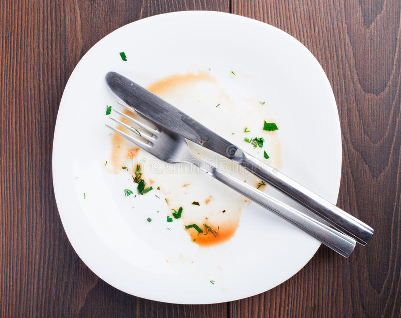 Empty plate left after dinner stock photo