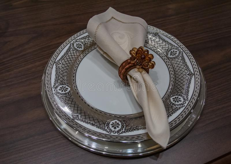 Empty plate with a napkin. Luxury wedding reception in restaurant. stylish decor and adorning. royalty free stock photos