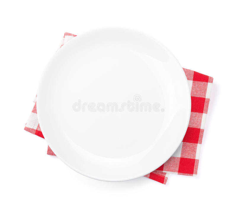 Empty plate over kitchen towel royalty free stock photos