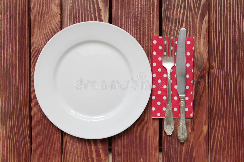Empty plate and silverware royalty free stock images