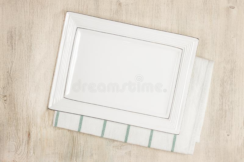 Empty plate and towel top view. Empty plate and towel napkin on wooden table - Restaurant backgtound top view royalty free stock photos